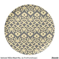 Intricate Yellow Heart Pattern Against Gray Dinner Plates