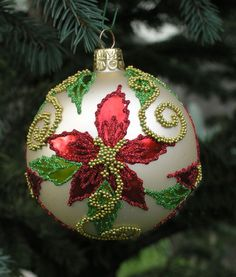 Beaded Poinsettia hand-blown glass Christmas tree ball ornament exquisitely detailed with beads and glitter. In shades of green and red and gold. Christmas Tree Dyi, Mexican Christmas, Painted Christmas Ornaments, Christmas Poinsettia, Elegant Christmas, Christmas Colors, Christmas Projects, Christmas Tree Ornaments, Holiday Crafts