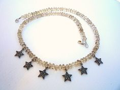 Elegant, Beautiful Natural Smoky Quartz gemstones and Sterling Silver Marcasite star charms are used to make this necklace.