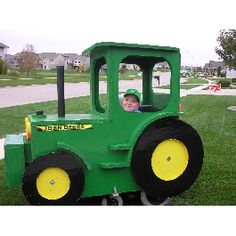 Trick or Treating in my John Deere Halloween Costume.... made to fit over a wheelchair but we could make it fit over a wagon....