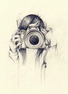 Girl holding camera drawing