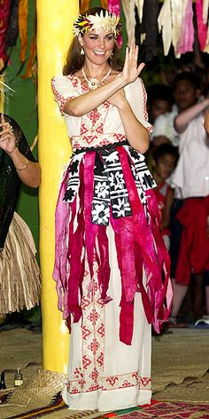 MOVES WITH SWAGGER  Her embroidered Alice by Temperley maxi dress is the perfect complement to the grass skirt and headdress Kate wears to show off her dance moves during a celebration in the royal couple's honor in Tuvalu.