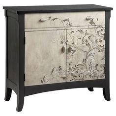 Featuring elegantly scrolling detailing on its front panels, this alabaster and charcoal-hued cabinet features 1 drawer and a bottom cabinet for stylish stor...