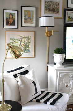 Something about this space...maybe it's the black and gold. The black frames really make the tv not so obtrusive. gallery wall around TV