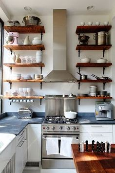 wooden shelves with white pottery.