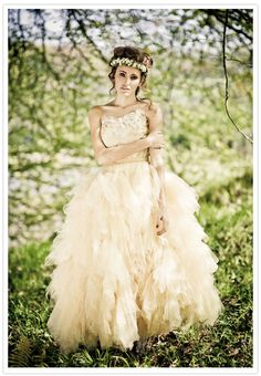 I love the fairy tale feel of this dress. It looks so light despite all the layered ruffles.