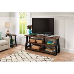 Add rustic charm and modern function to your home theater with the Better Homes and Gardens Mercer 3-in-1 TV Stand. Featuring hand-finished metal frame and brown ash veneer shelves, this unit is the perfect solution for your 70-inch flat panel TV. The patented 3-in-1 feature allows you to incorporate your TV as a tabletop, swinging floater or wall mount. The included 2.0 USB hub offers easy accessory integration. The tilt and swivel features offe * Check out the image by visiting the link.