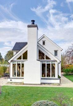Stark white painted chimney and glazed gable