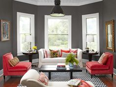 """If a room gets a lot of light, you can try a rich paint color. """"This gray, Dark Ash by Behr, makes the room feel cozy, not cavelike, which is a tricky balance,"""" says Gretchen."""