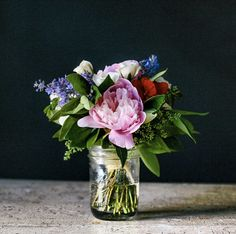 simple blooms in a mason jar | styling: Rebekka Seale, via Frolic