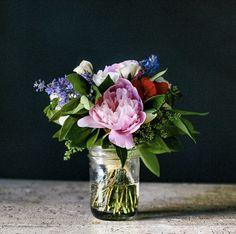simple blooms in a mason jar   styling: Rebekka Seale, via Frolic