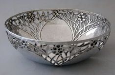 CHARLES ROBERT ASHBEE (1863-1942)  An Arts & Crafts, silver bowl, pierced with a design of fruiting branches.. Liberty & Co.
