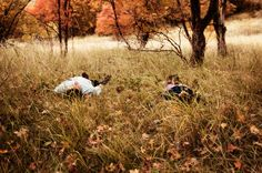 www.frostedproductions.com | #utah #photographer #engagement #photography #cute #couple #laying #in #the #grass #fall #leaves #field