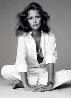 Seventies looks: All one color, natural hair shimmery makeup & simple jewelry. (Don't forget a plunging neckline!) Lauren Hutton.