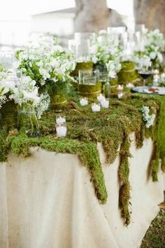 SO PRETTY! Who would have ever thought to use moss on the table top.
