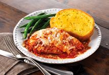 In less than an hour, you can make this simply delicious chicken dish, baked in a flavorful tomato sauce and topped with mozzarella and Parmesan cheeses.It′s a winner!<br />