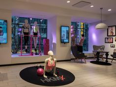 Flatscreen with interactive scent diffuser in the back corner on the right Visual Merchandising Fashion, Merchandising Ideas, Mannequin Display, Fitness Stores, Retail Concepts, Text On Photo, Retail Space, Display Design, Retail Design