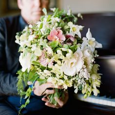lush green bouquet of orchid, dogwood, tea rose, carnation, silene, columbine and sweet pea by Tulipina