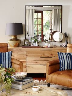 Natural wood furniture and beachy navy and white accents are chic without being fussy — perfect for a home with young children.