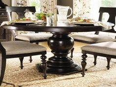 Black Wooden Round Dining Table With Glass Teapot And Curtain ~ http://lanewstalk.com/simple-yet-classy-round-dining-table-design/