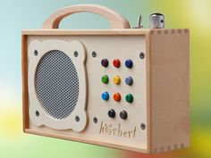 The Horbert. A portable MP3 player made for children. Parent scan download music or audiobooks onto a memory card.