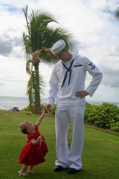 Sailor dad and daughter in red dress photo shoot