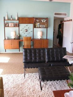 Mid-Century Modern cabinets. Love this look for your bar area. A mix of closed cabinets and open shelves. In walnut to match the shelves by the fireplace.