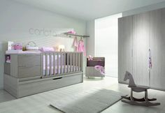 Chic grey baby girl bedroom with a pop of pink
