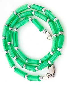 green plastic bead bracelet made from soda bottles that were rolled and then heat shrunk.