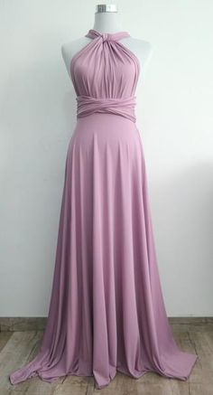 """Questions? Call us Monday - Friday 6pm - 10pm CST at 1(312) 212-3724 LilZoo Knee Length Convertible Infinity MultiWay Wrap Dress in Lavender This Listing Includes: One Full Length ( 42"""" from band ) Convertible Dress in Lavender Purple One Bandeau tube top in Lavender Purple FAQ: Q: How many Ways can this dress be worn? A: Dozens! The options are endless, the styles are changed by simply twisting and tying the dress straps. You can view some of the most popular styles, along with how to ..."""