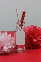 For in amongst various jars/cotainers for table decorations