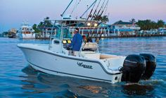 "Mako 234 CC: The Mako 234 rides again! But this Mako is far better than she ever was in the ""good old days. Jet Ski, Mako Boats, Center Console Fishing Boats, Offshore Fishing, Layout, Once In A Lifetime, Salt And Water, Saltwater Fishing, Boat Building"