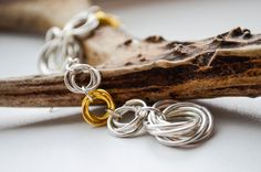 Items similar to chain maille earrings, chainmail jewelry, silver and gold earrings, dangle earrings, chainmaille jewelry on Etsy Chain Mail, Dangle Earrings, Dangles, Trending Outfits, My Style, Unique Jewelry, Bracelets, Handmade Gifts, Silver