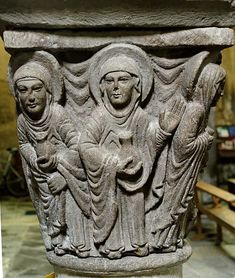 The Holy Women at the grave. Sculpted Romanesque capital from the former choir of the abbey-church in Mozac, 12th century.