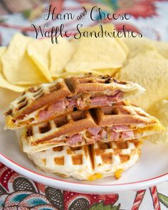 Ham & Cheese Waffle Sandwiches Recipe - ham and cheese stuffed inside a refrigerated biscuit and cooked in the waffle iron. SO much fun to eat!!