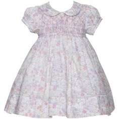 Hand smocked infant and toddler dress in Liberty of London Cotton.