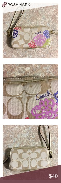 Coach Signature C Wristlet Coach Wristlet with floral design.  Has a small mark on the back (shown in second picture).  Inside is very clean and this is a very cute style! Coach Bags Clutches & Wristlets