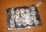 Girl Scout Swaps - sheet full of cookies: cookies made with hole punch and foam and then glued onto folded tin foil.. marker for the chips.. love this one!! omg the possibilities!! :))