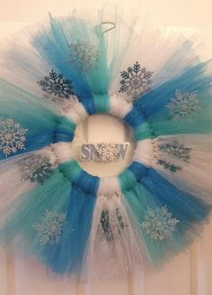 Frozen, Elsa inspired tutu wreath- $35. Made by Becky Davino of Little Red Wagon Creations. https://www.facebook.com/MemoryNeverEndingShop