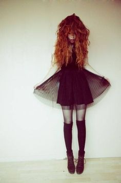 curly hair like this please with black dress and long socks to the side