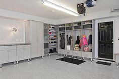 There's plenty of storage space for the entire family in this garage filled with tall cabinets with Lucite doors. A mudro… – garage Garage Renovation, Garage Interior, Garage Remodel, Garage Furniture, Dark Furniture, Kid Furniture, Cardboard Furniture, Room Interior, Bedroom Furniture