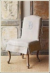 option for slipcover:  vertical side ties on chair back and heavily embrodiered monogram, little skirt at seat