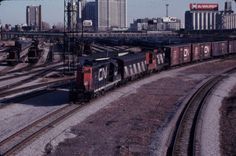 Canadian National   4527  Toronto, ON  This original slide is in focus and well exposed. The scan is low resolution and does not come close to matching the quality of the original slide.  Little or no information about the slide is marked on the mount. This slide was taken on a sunny day in 1982.