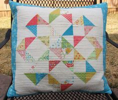Moda Bake Shop Gorgeous Candy Flowers pillow.  Would make a GREAT quilt!  Of course, free Moda tutorial.