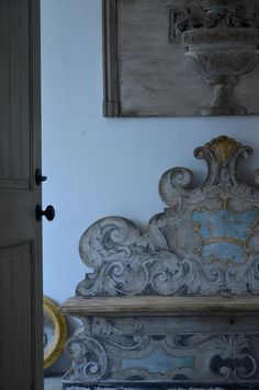 Painted bench and antique carved panel in the home of Lars  and Nadine Bolander. Palm Beach.