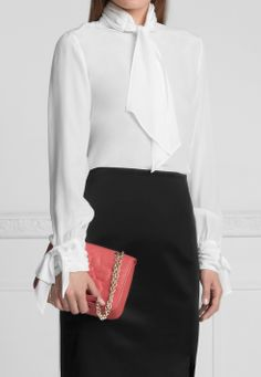 Mariana Silk blouse by Anne Fontaine with long sleeves and fancy draped cuff with bow. Repeat of draping on collar, finished off with a large lavaliere bow.