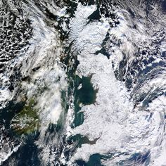 Isle of white: this image taken by NASA's Terra satellite shows the extent of ice and snow covering Britain on 7 January 2010