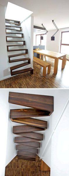 13 Ideas de Diseño de escaleras para espacios pequeños // Una escalera de la cinta es una gran idea para un pequeño espacio porque es más vertical que una escalera tradicional, que todavía tiene amplias bandas de rodadura, y se crea un punto focal único en su hogar.