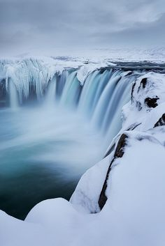 One of the most spectacular waterfalls in Iceland is Godafoss, the Waterfall of the Gods. It is beautiful and scenic during winter when snow and ice frame it, making it even more great and powerful in its expression. The water range from light blue to dark. It is said to host statues of the Norse gods thrown in it in protest, when Christianity became the official religion of Iceland.