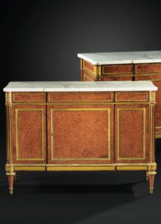 A PAIR OF GILTBRONZE MOUNTED BURR YEW COMMODES À VANTAUX, LOUIS XVI, STAMPED A…